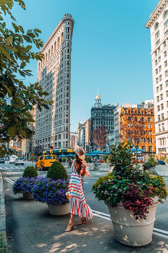 Kristi Hemric (Instagram: @khemric) walks through Madison Square Park in front of the Flatiron Building in NYC