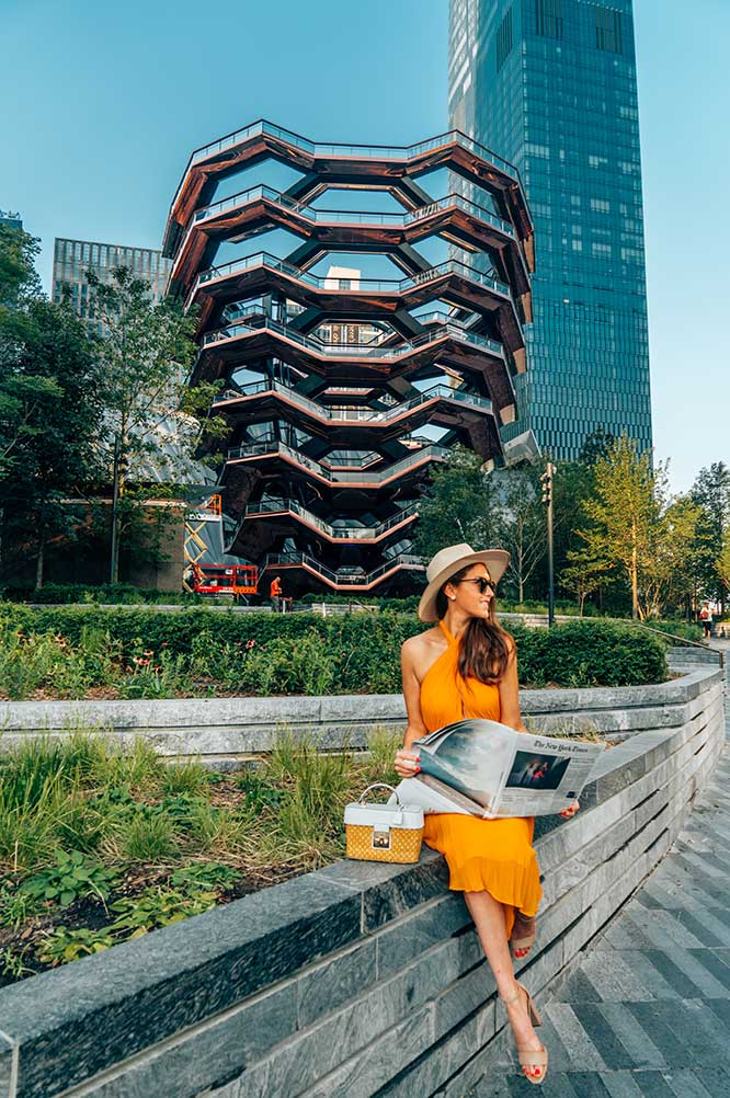 Kristi Hemric (Instagram: @khemric) poses for a photo while catching up on the news at The Vessel at Hudson Yards