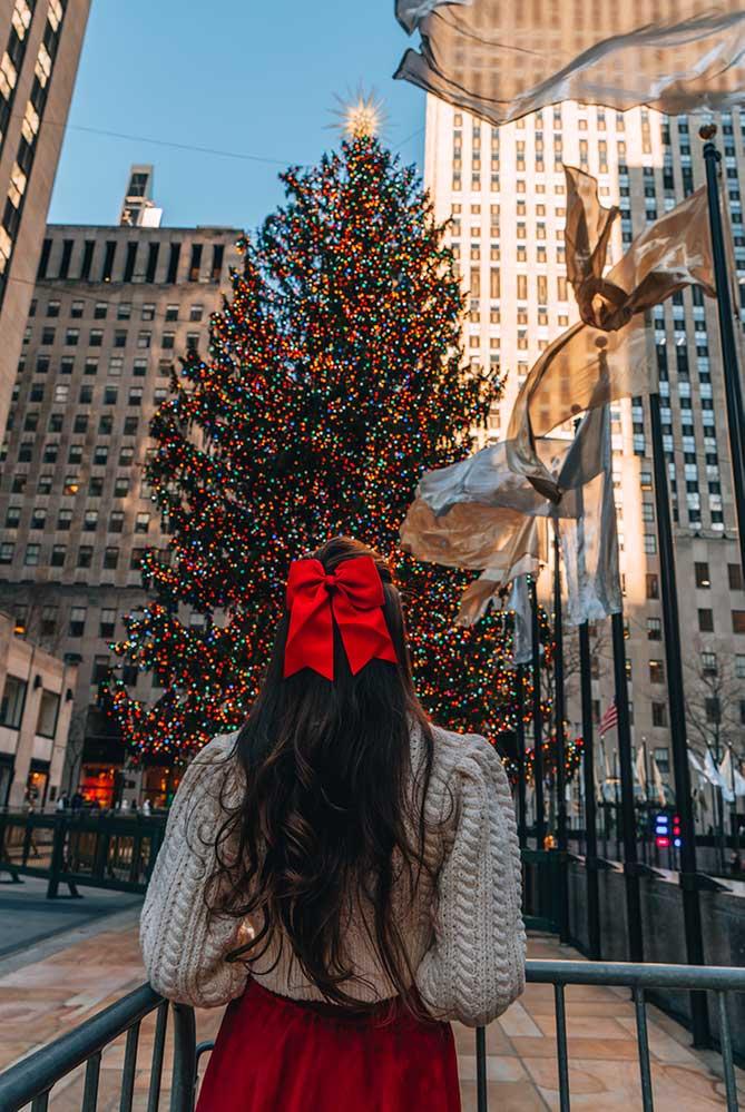Kristi Hemric (Instagram: @khemric) checks out the iconic Rockefeller Center Christmas Tree in New York, NY