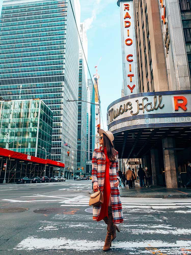 Kristi Hemric (Instagram: @khemric) walks down an empty 6th Avenue in New York near Radio City Music Hall